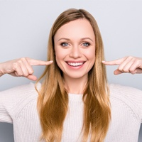 woman pointing smiling