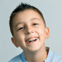 Smiling young boy with braces