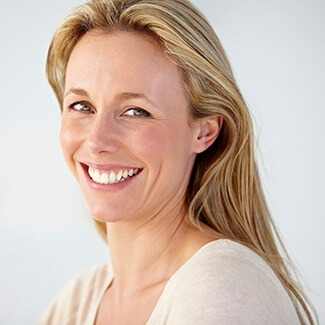 Blonde Woman smiling brilliantly