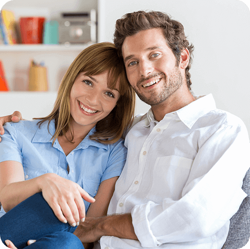 Couple smiling in living room