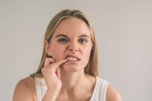 woman dealing with oral health problems