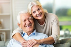 Mature couple cuddling and smiling
